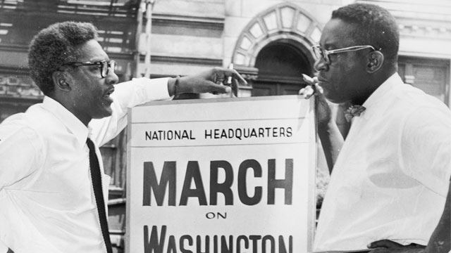 In front of 170 W 130 St., March on Washington, Bayard Rustin, Deputy Director, and Cleveland Robinson, Chairman of Administrative Committee (left to right). World Telegram & Sun photo by O. Fernandez. (Library of Congress's Prints and Photographs division)